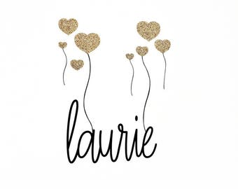 Personalized name stickers, and its golden hearts balloons.