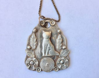 a cat pendant necklace in sterling, with spiral
