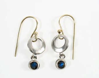 Hollow Sterling silver with dangling 5 mm cabochon stone set in silver on yellow gold wire.
