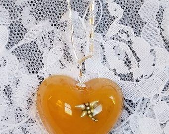 Dragonfly in Amber Heart-shaped Resin Necklace Silvertone Chain