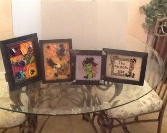 Set of four needlepoint Halloween pictures.
