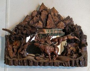 Cougar pouncing on elk wood carving wildlife mirror featuring raccoon hawk turkey rabbit squirrel