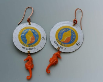 Bottle cap earrings. Florida Beer Company. Coral, blue, gold, and silver. Recycled, upcycled jewelry. Seahorses. Long earrings. Reuse.