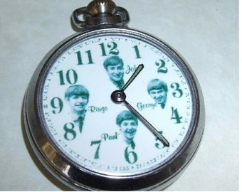 Free worldwide tracked shipping...Vintage The Beatles Picture dial pocket watch