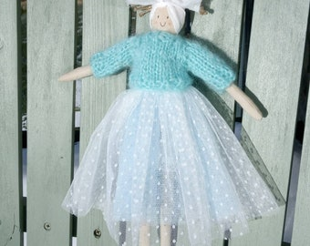 A handmade doll with a frothy skirt and a hand knitted mohair jumper