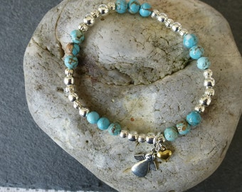 Turquoise and silver plated beads stretch bracelet