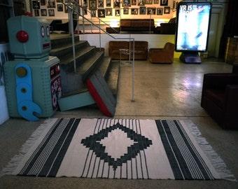 Hand loomed kilim style rug aztec design