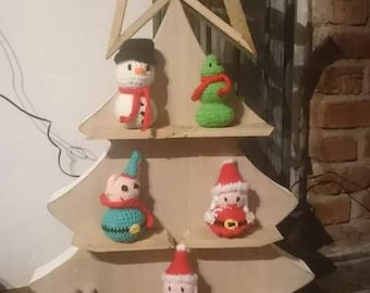 Wooden Christmas tree with crochet dolls.