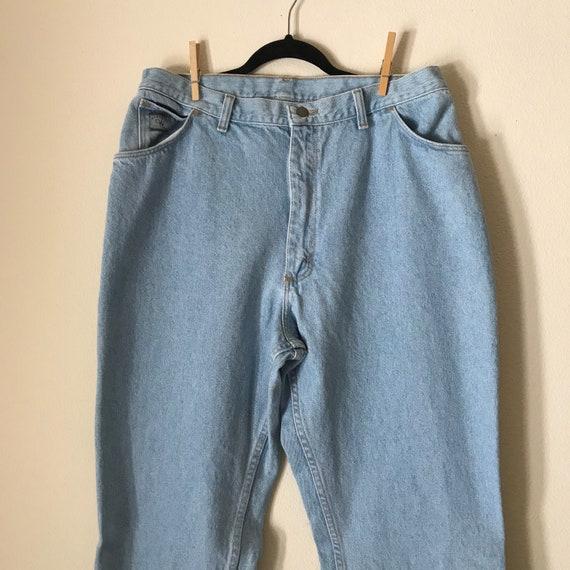 Plus Size Wranglers | chambray 90s vintage light blue jeans denim wrangler western riding 34 waist xxl 2xl xl extra large minimal normcore