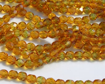 Topaz and Green 6mm Faceted Fire Polish Round Beads   25