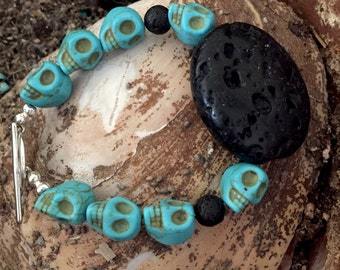 Turquoise skull bracelet with lava rock and a sulver rose toggle closure, skull bracelet with black lava, tu