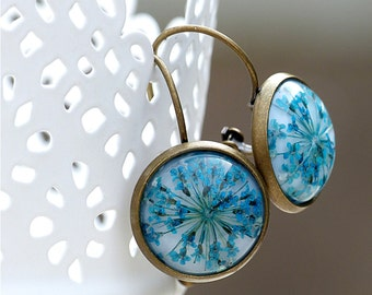 Natural earrings with a real dried flower.