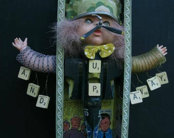 Up up and Away altered doll art assemblage art, wall art with vintage toy aeroplane
