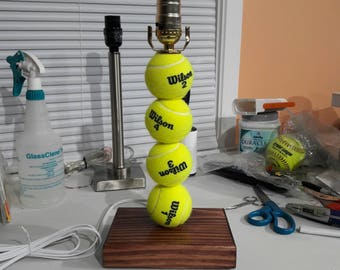 Tennis ball lamp.  Made with real tennis balls