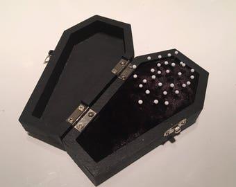 Black casket pin cushion