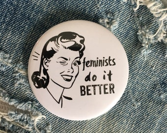feminists do it better!  pin back button, 3 sizes available, mirror keychain