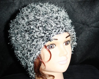 novelty yarn with curly, bouncy hair and wool hat,
