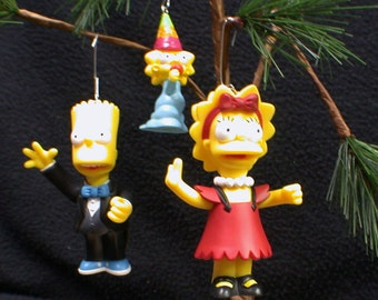 The Simpsons Chritmas Tree Ornament Brat , Lisa and or Maggie Simpson Funny lot