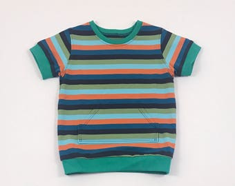 Multi Stripes Shirt. Boys Tee Shirt. Organic Boy Shirt. Jersey Knit Tee Shirt. Canguru Pocket. Boy Tee. Cuffed Sleeve. Short Sleeve. Stripes