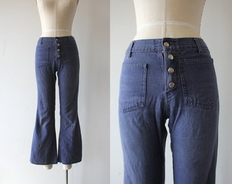 vintage 1960s jean / 60s flared denim / 70s bell bottom pants / 70s bell bottom jeans / 60s hip hugger jeans / 26 inch waist small XS