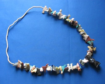 Vintage early Navajo fetish necklace large pieces bears turtles birds squirrels hand carved and polished hand woven