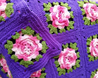 Pink Rosettes Green Leaves Afghan Spread of Granny Squares on Purple Field