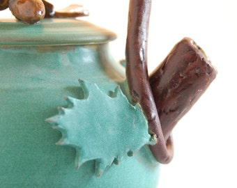 """Teapot, hand thrown porcelain with """"twig"""" handle and leaf decoration, matte green and white glaze,functional"""