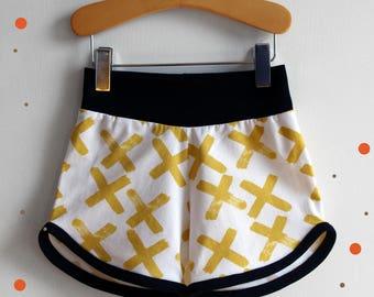 "Short black and gold mixed organic jersey, printed ""Cross"""