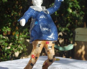 Turner's carving paper mache snowman in motion