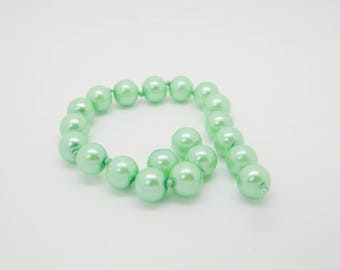 140 x 7mm Green mother of Pearl round bead (l1284)