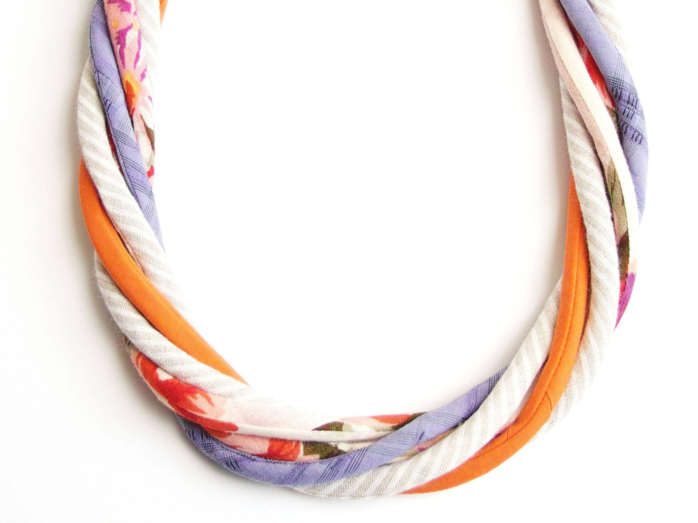 view photo on from necklace stock and white glass isolated of batik top background pink bone beads textile silk