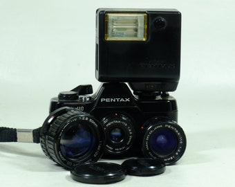 Pentax Auto 110 Camera with three Lenses and Flash