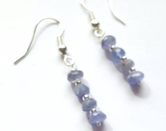 Sterling silver and genuine tanzanite drop earrings. Faceted tanzanite rondelles and sterling silver beads. Blue drop earrings.