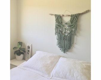 Green macrame wall hanging