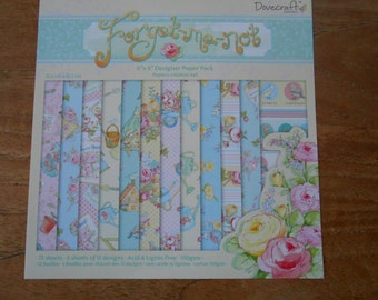 "Dovecraft ""Forget Me Not"" 12 sheets. 6"" x 6"" . 150gsm cardstock. Acid and Lignin Free. Card making. Scrapbooking. Papercrafts."