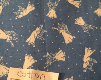 White Angel fabric with blue background