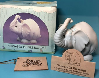 "Vintage Precious Moments Figurine. This is a 1987 Retired Figurine, ""Showers of Blessings"""