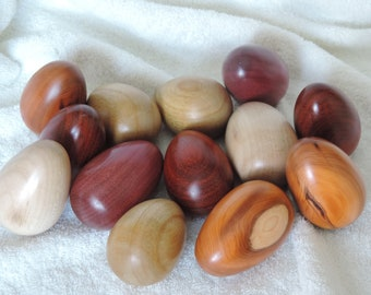 WOODEN EGGS, a hand turned egg in various hardwoods