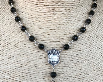 Delicate rosary style necklace in black jade faceted 5mm beads with center station and crucifix. Custom made to order.