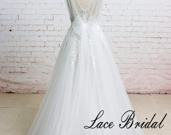 Off White/Ivory A Line Wedding Dress with Plunging Neckline and Lace Appliqued Flowers