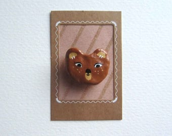 Love the little bear brooch