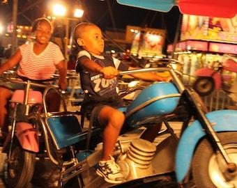 Boy Handling Motorcycle at Carolina Beach Carnival Ride