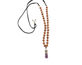 Divine Omen (AMETHYST) - a light colored wood and silver necklace on an adjustable brown leather cord with natural raw gemstone pendant