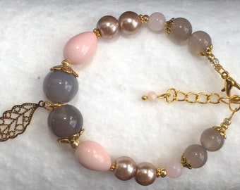 Gray and pink bracelet with a leaf