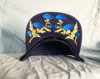 Navy blue cap with royal blue thistle crown
