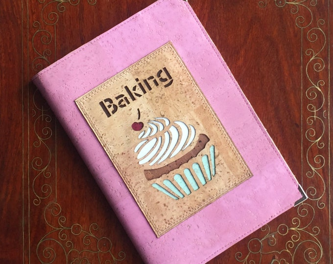 Vegan A5 baking recipe book made from pink cork leather/cork fabric with an appliqué of a cupcake backed in coloured cork