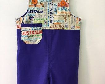 Size 2 Blue Shortalls/overalls with Australian print and orange buttons 100% cotton
