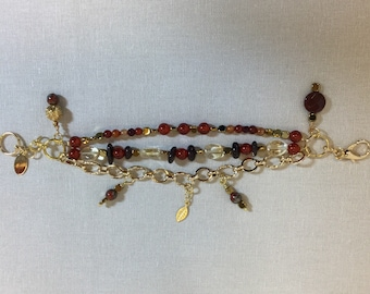 Triple strand charm bracelet with carnelian, garnet, hematite and citrine