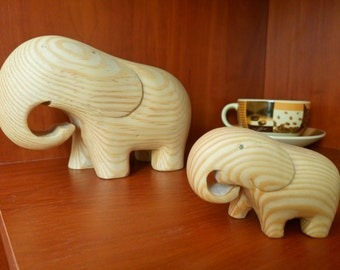 Wooden carving statuettes of elephants. The family of elephants . Mother and child. Montessori waldorf toy.