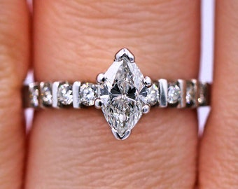Delicate engagement ring with 0.55cts  marquise shape diamond